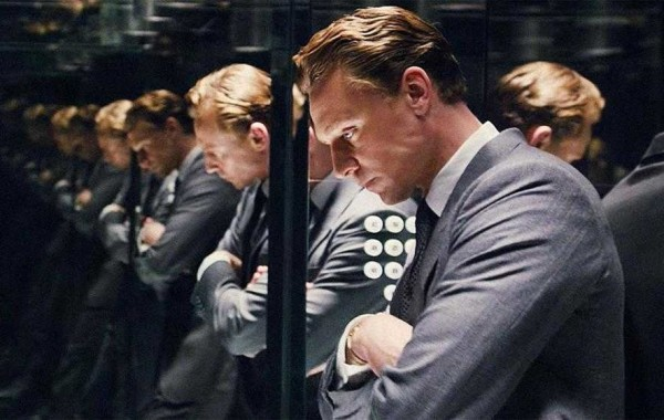 Tom Hiddleston folded arms in mirrors High Rise