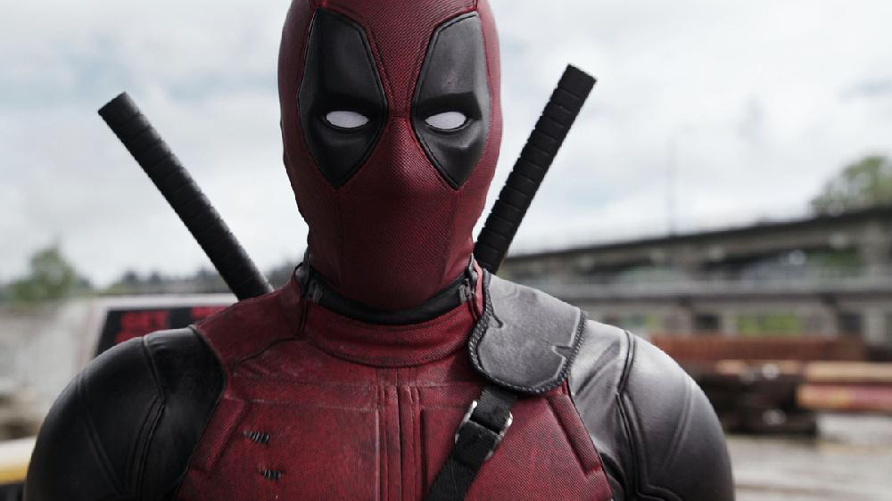 Deadpool on rooftop with guns