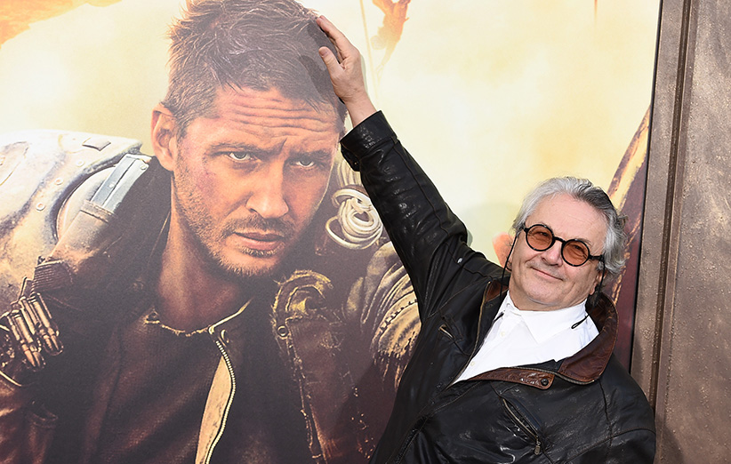 George Miller rubbing mad max poster