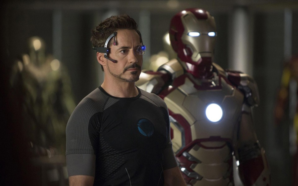 Robert Downey, Jr. as Iron Man with suits