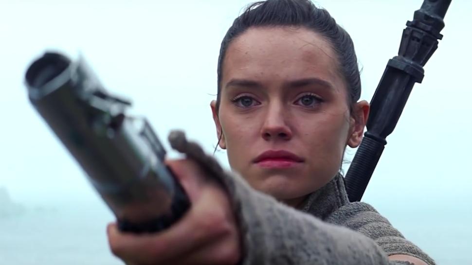 Rey holding lightsaber to Luke