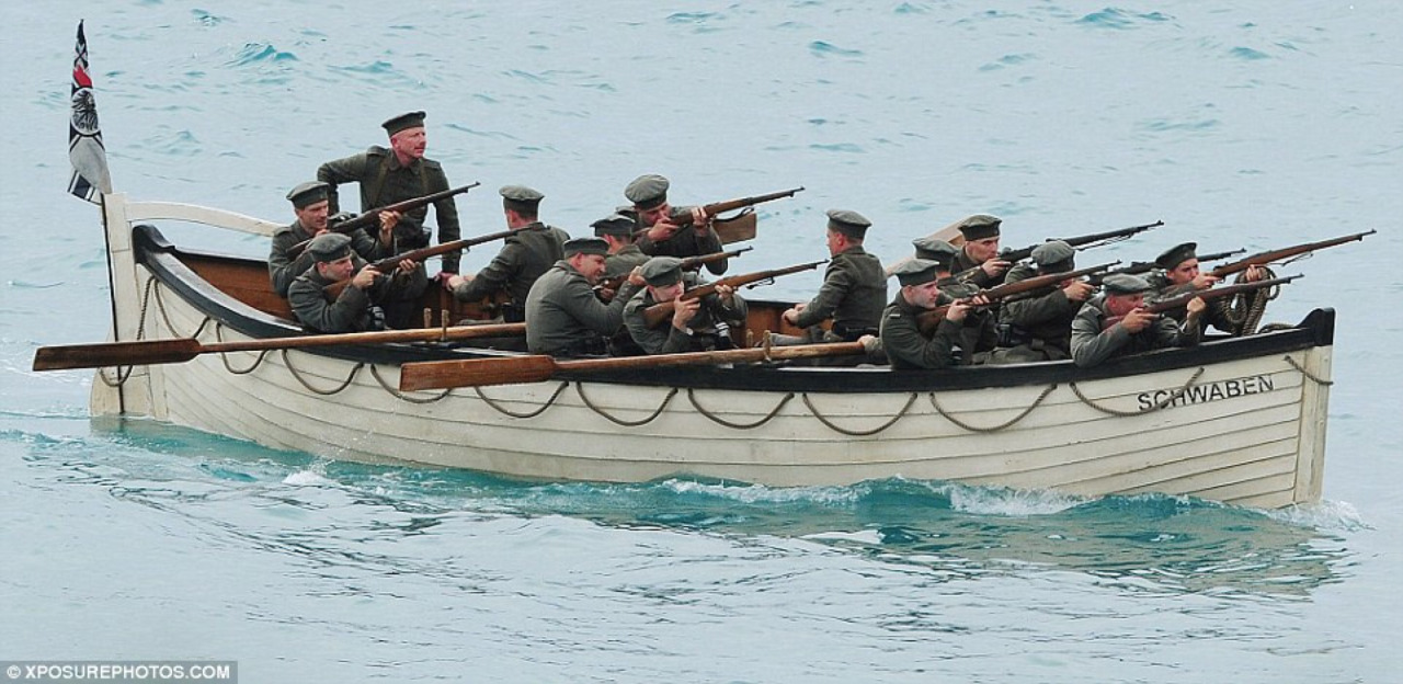 Guys on boat in Wonder Woman