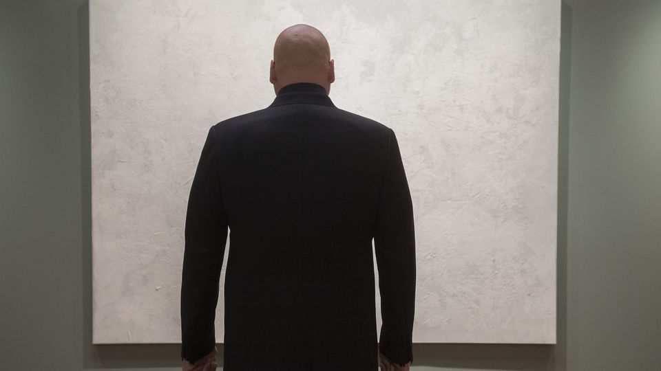 Daredevil's Wilson Fisk Kingpin staring at white painting
