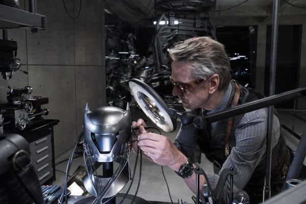 Jeremy Irons as Alfred Pennyworth working on Batman's cowl