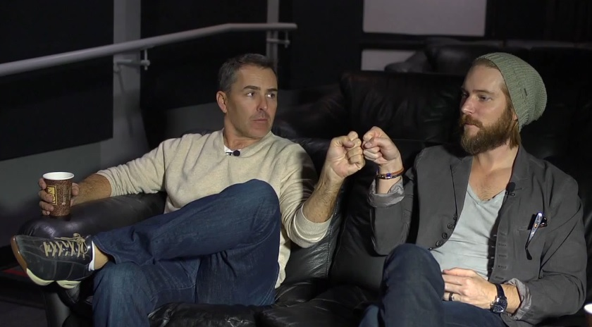 Nolan North and Troy Baker fist bump