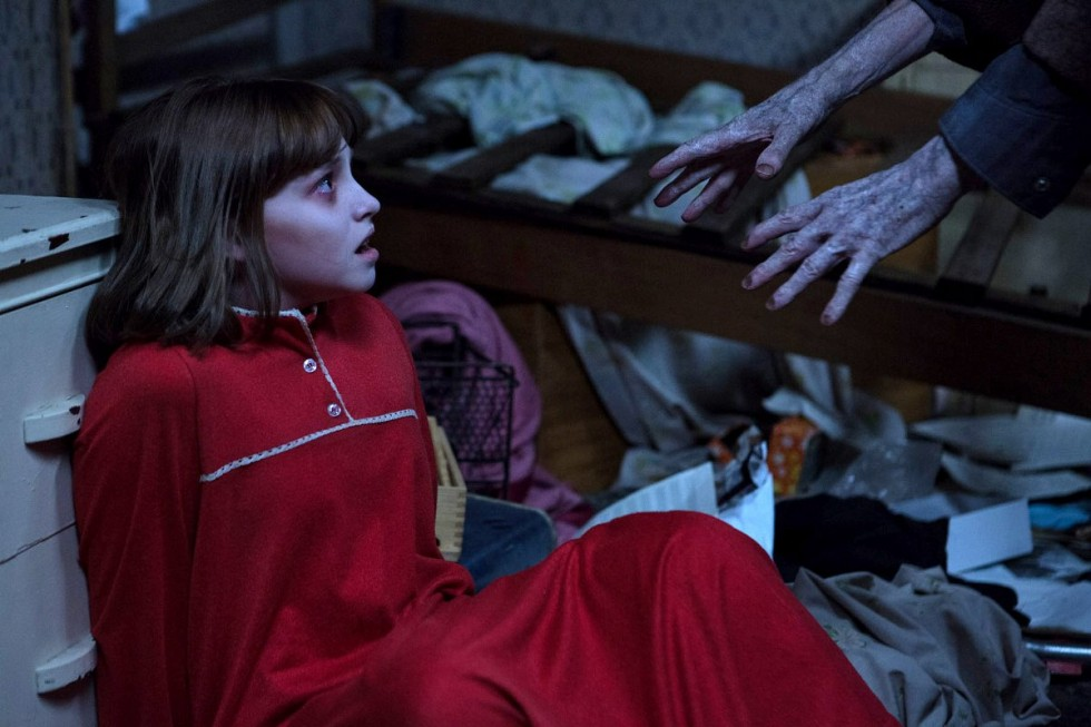 The Conjuring 2, girl in red dress, creepy hands reaching