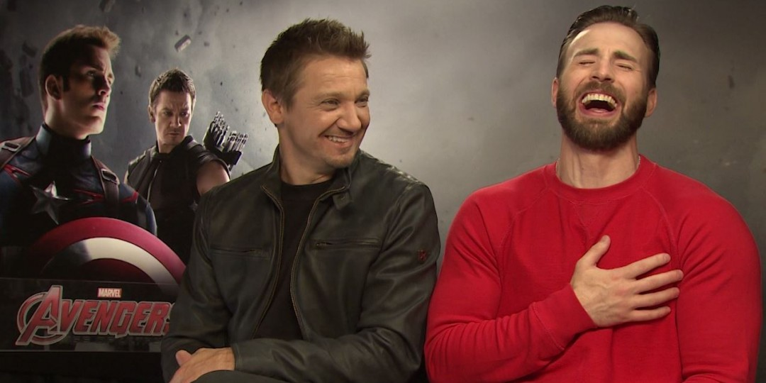 Jeremy Renner and Chris Evans laughing left boob grab