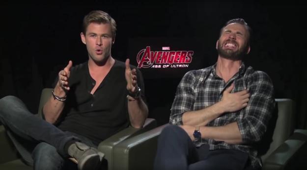 Chris Hemsworth and Chris Evans laughing left boob grab