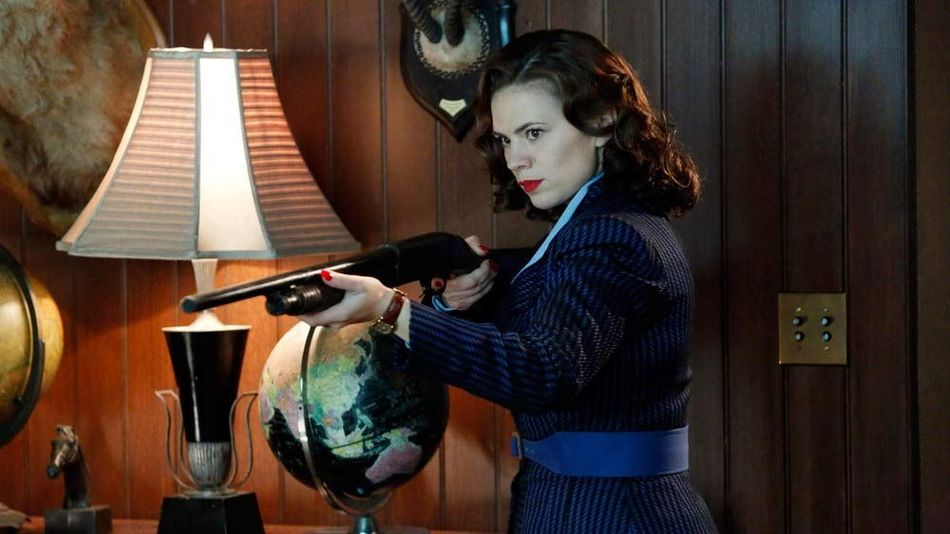 Hayley Atwell as Agent Carter wielding a shotgun