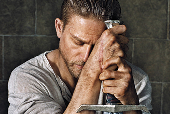 Charlie Hunnam as King Arthur via Entertainment Weekly
